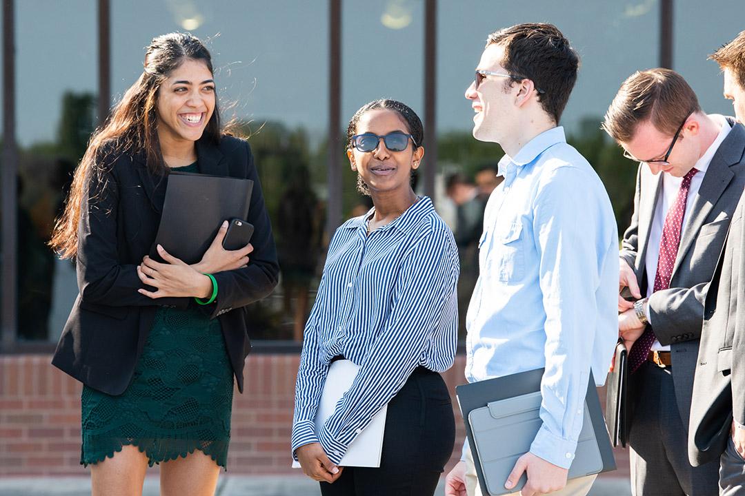 Students talk outside Gordon Field House.