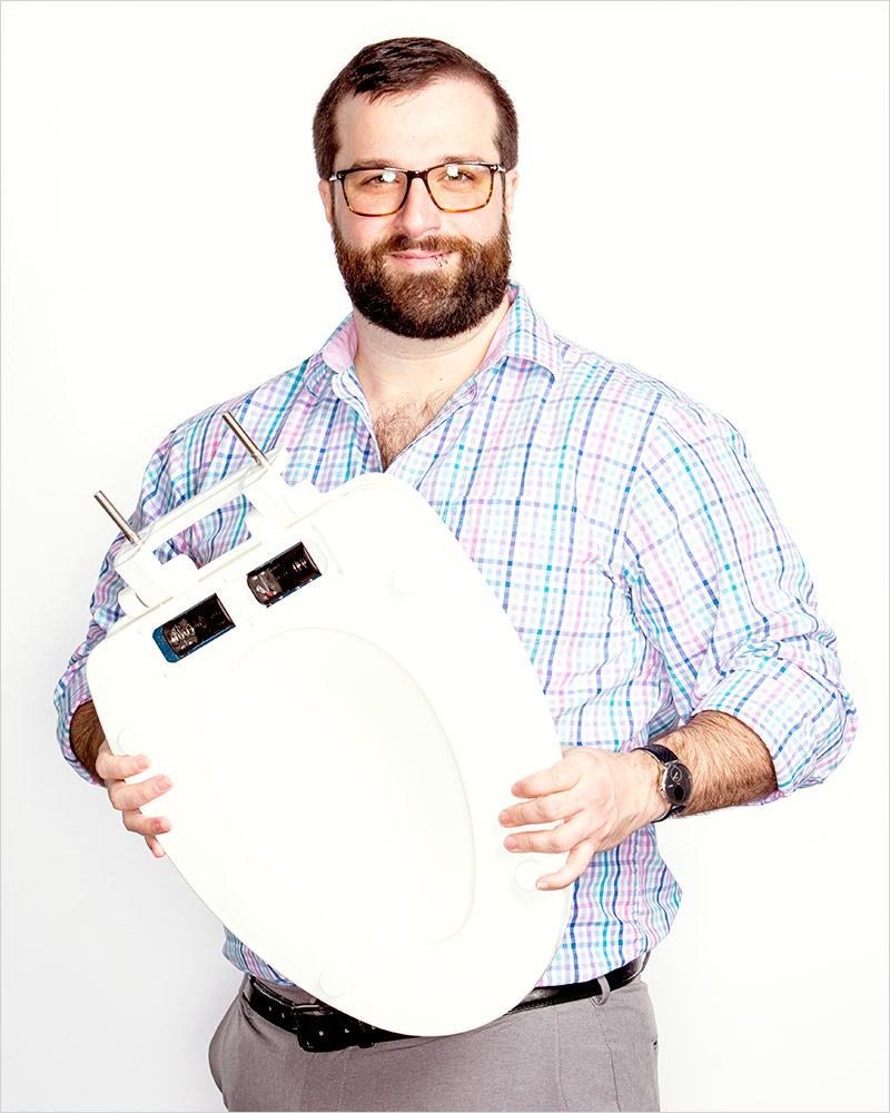 researcher holding toilet seat.