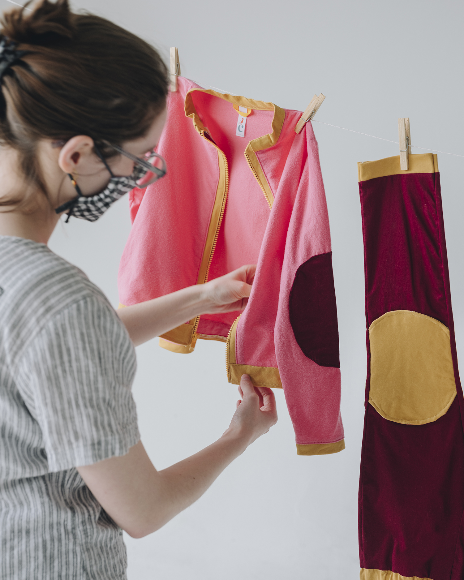 Daeya Shealy hangs clothes she designed from a clothesline.