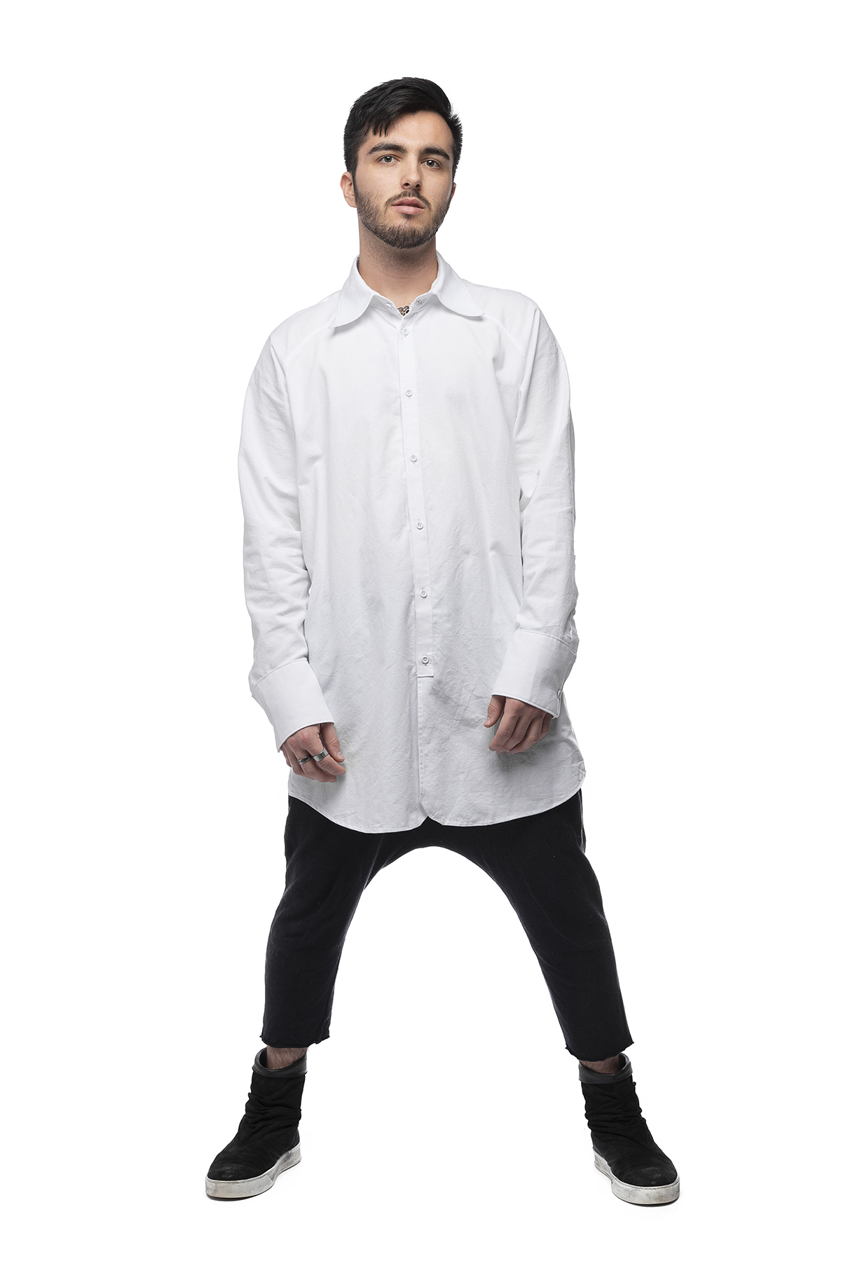 A functional clothing design of a white shirt and short black pants.