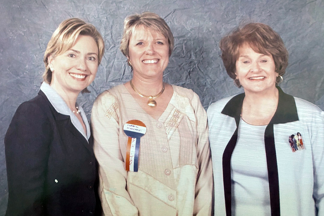 three women standing together.