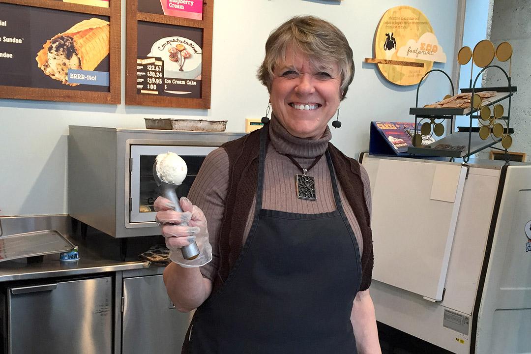 woman with ice cream scooper