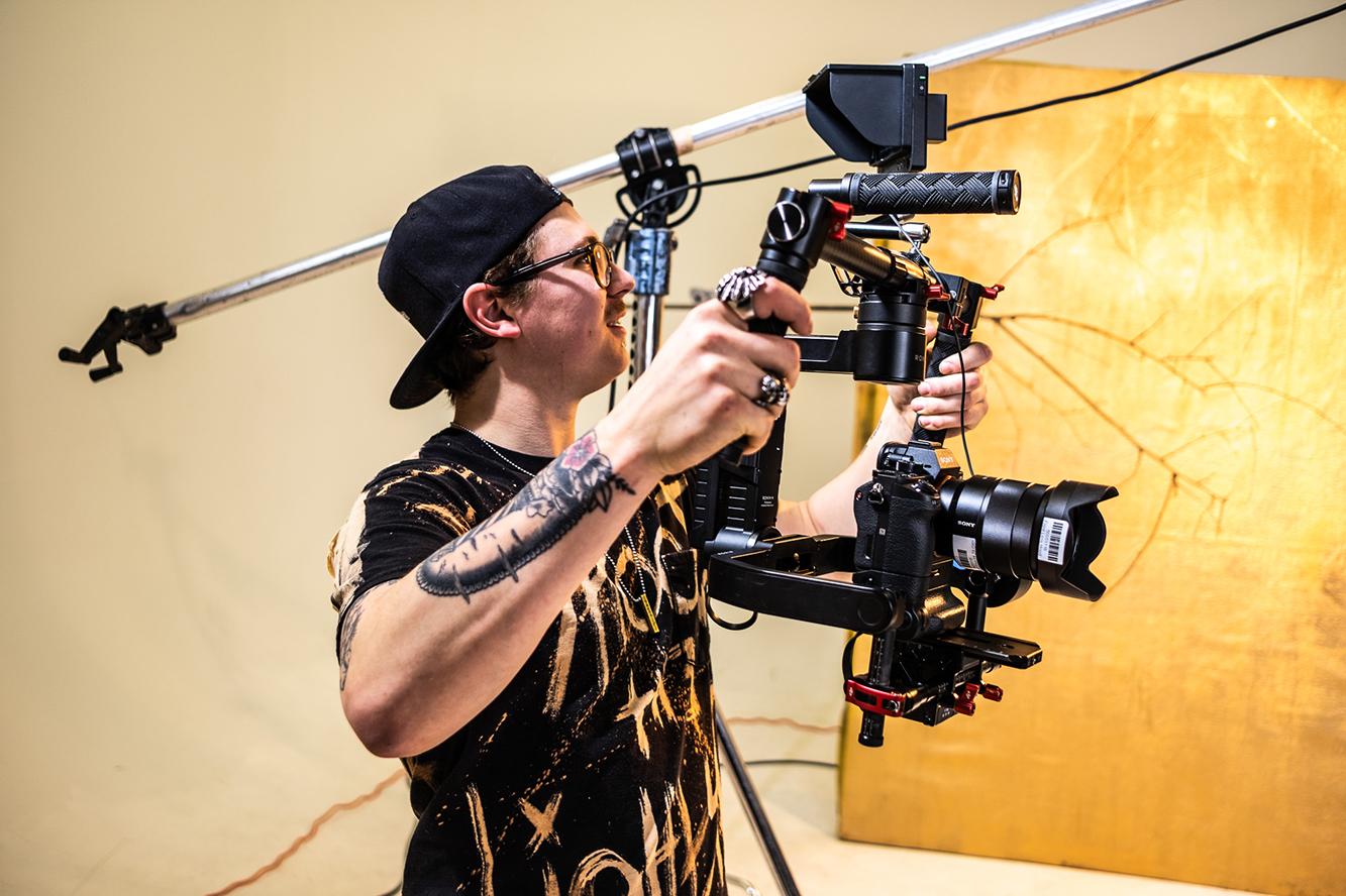 A student operating a camera
