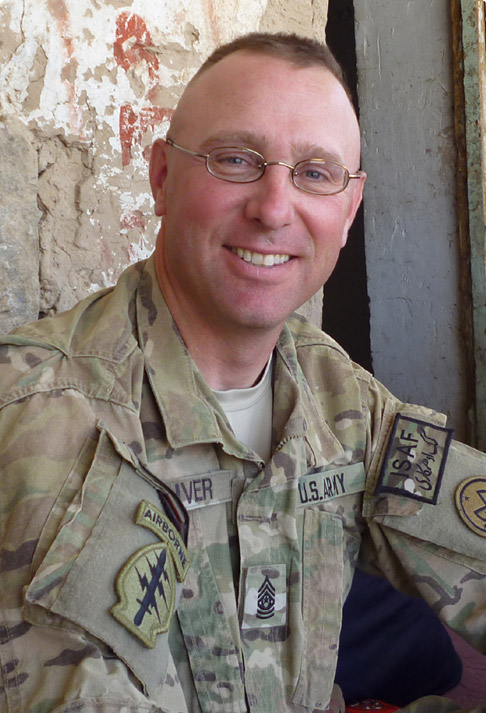 portrait of David Oliver in Army fatigues.