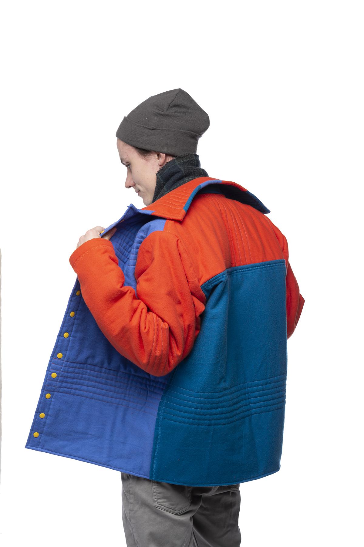 A design of a vibrant blue and orange winter coat.