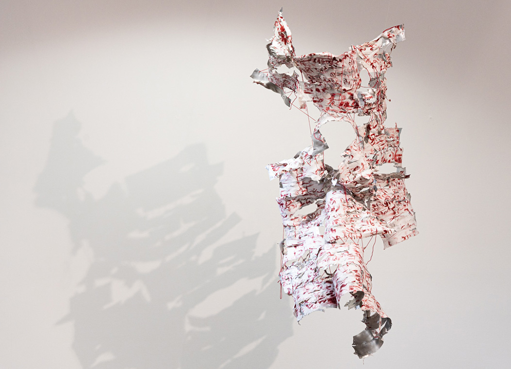 A piece constructed on fabric on aluminum.