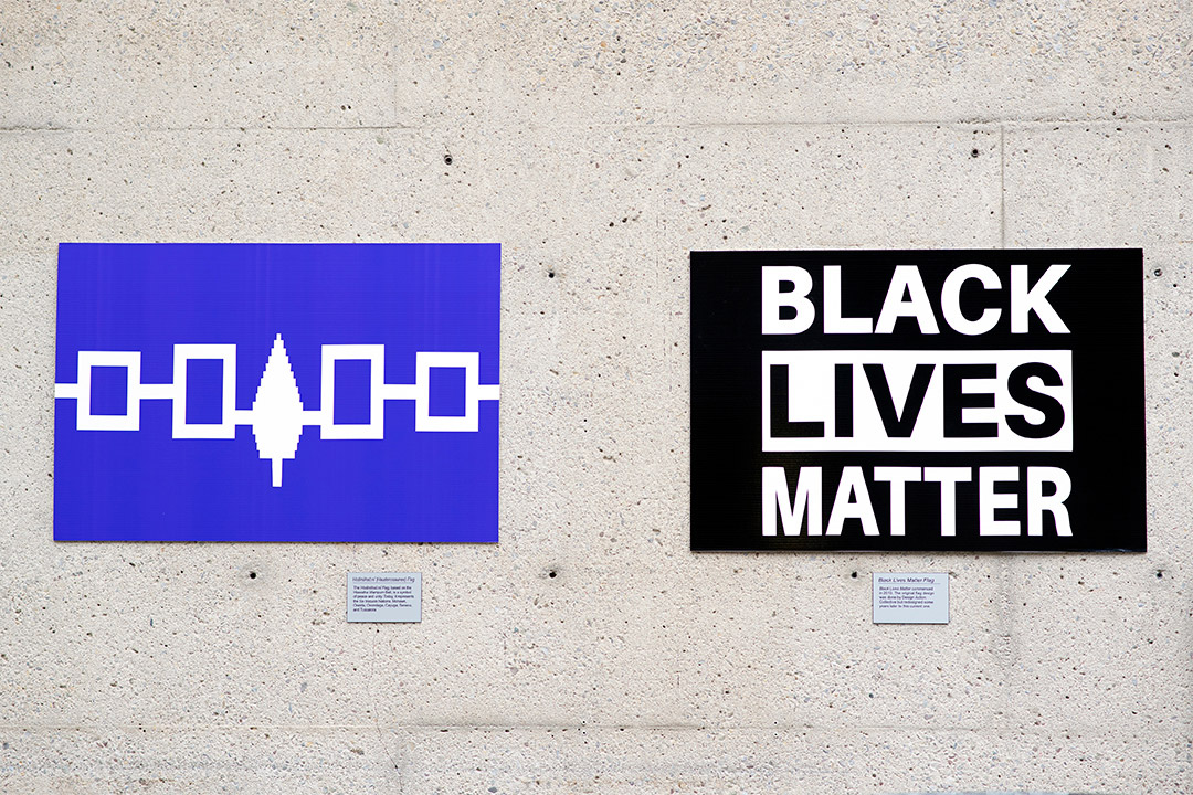 the Haudenosaunee flag and the Black Lives Matter flag.