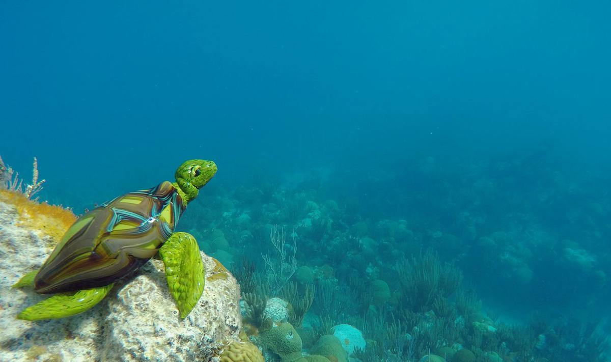 a glass turtle in the sea