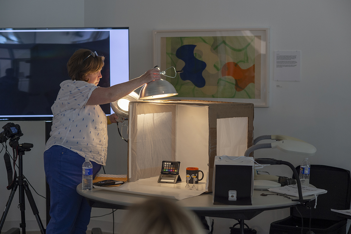 Nanette Salvaggio demonstrates how the cardboard lightbox is used.