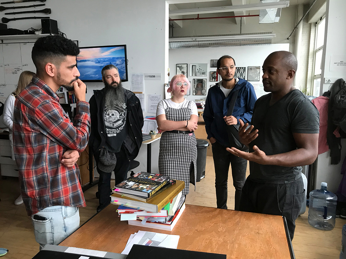 Students interact with artist Hank Willis Thomas.