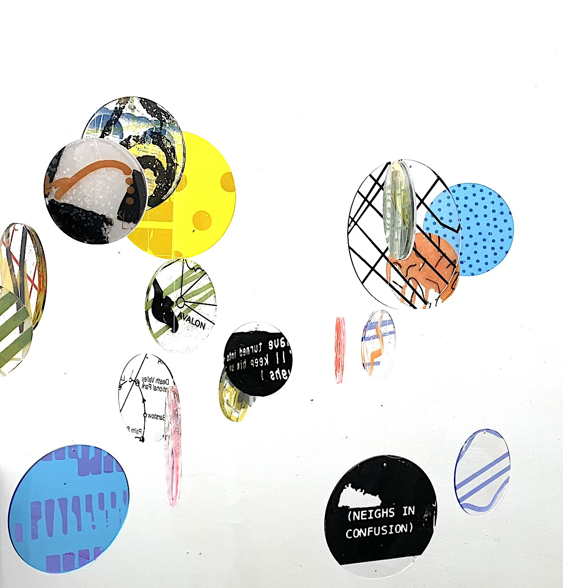 A print of a series of inks on plexiglass discs. It's part of a larger interactive installation.