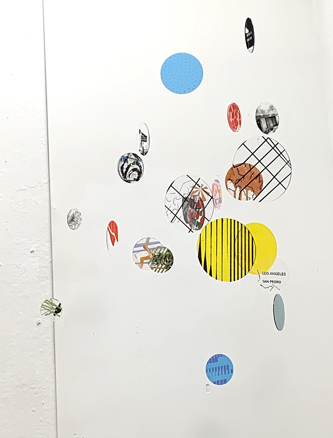 A print of a series of inks printed on plexiglass discs. The piece is part of a larger interactive installation.