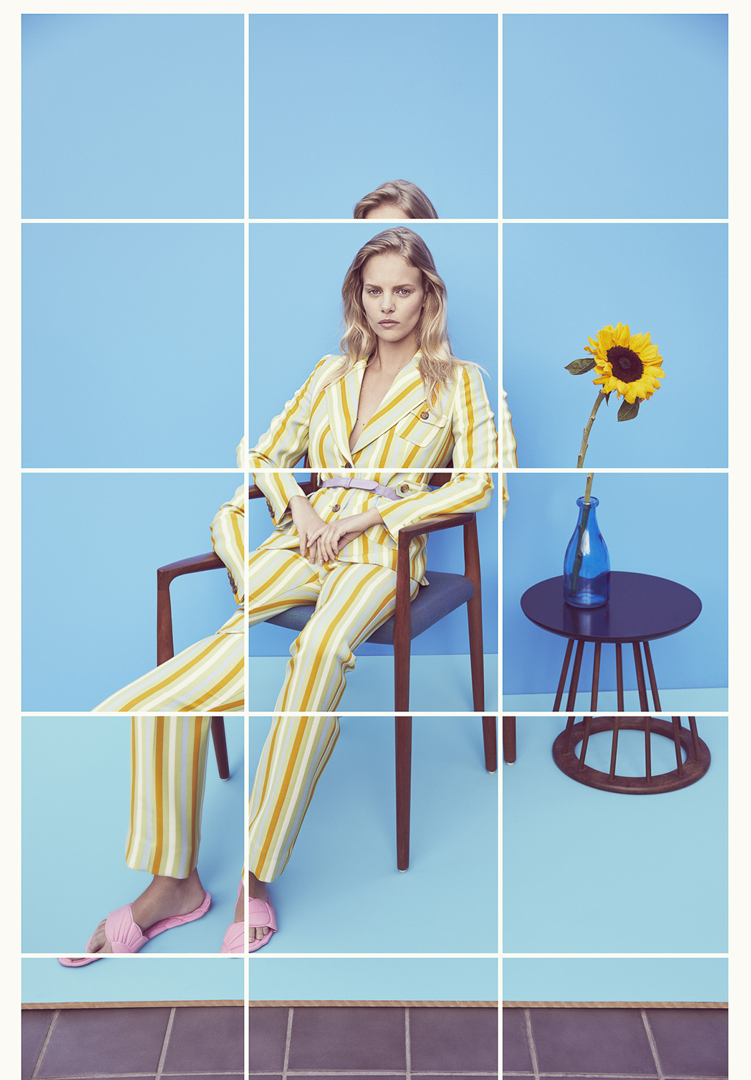 a Fashion shoot of a woman sitting in a chair