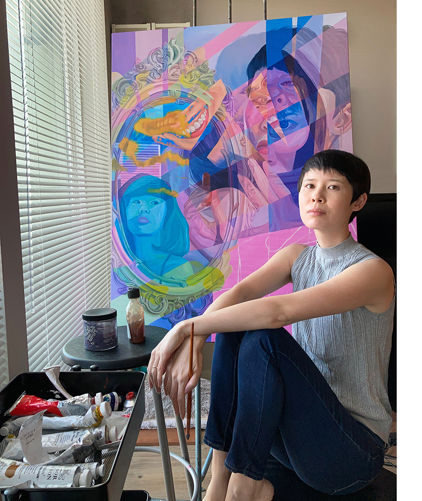 Melissa Huang poses in front of an oil painting of hers.