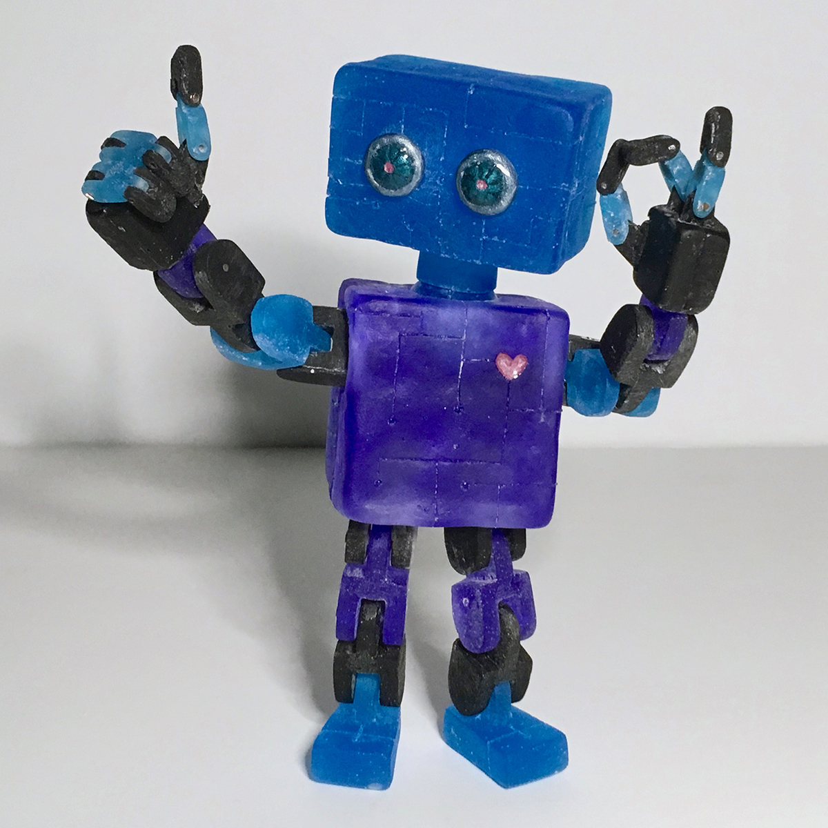 A small toy robot sculpture.