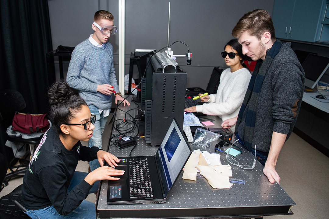 four students working on imaging device.