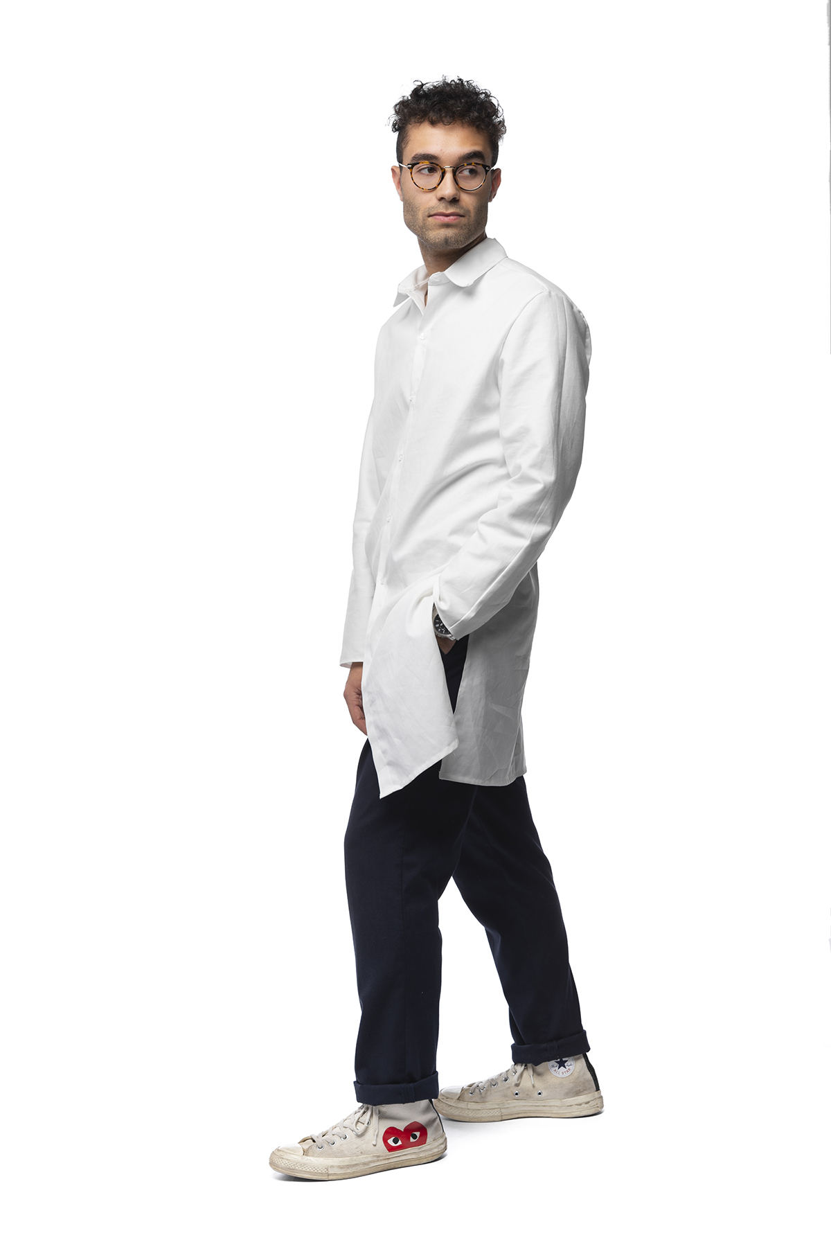 A functional clothing design of a long-sleeved, white shirt that goes down to just above the knees.