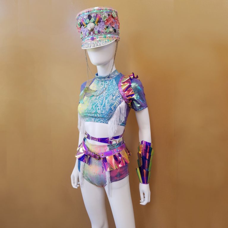 A  mannequin wears a colorful hat and outfit, part of a fashion design line.