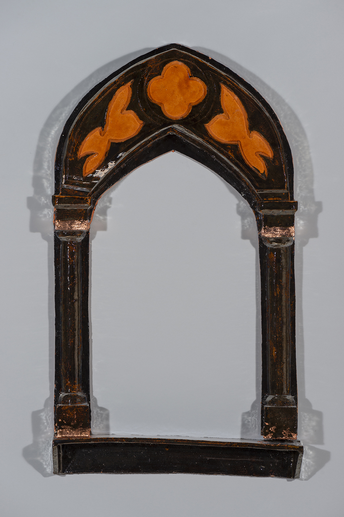 a ceramic frame mounted on a wall.
