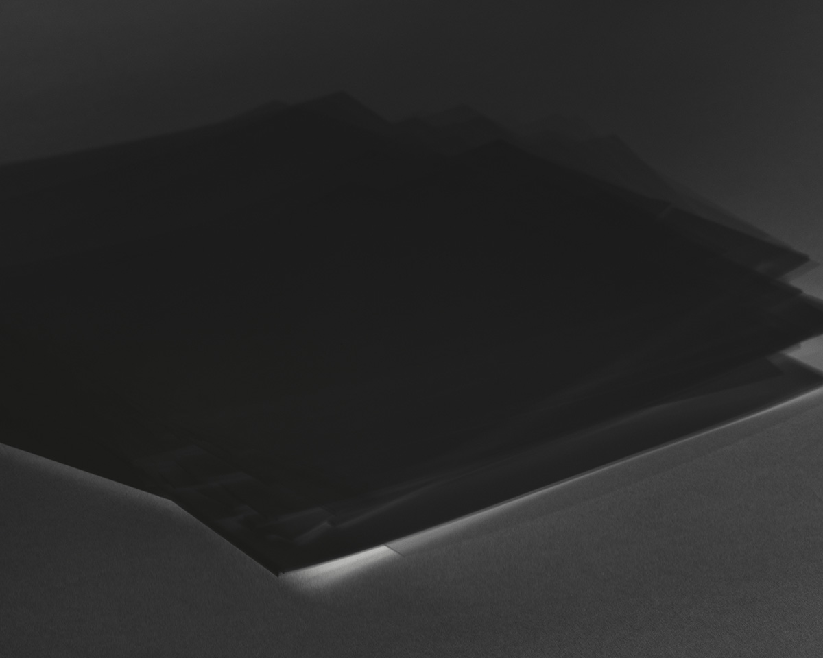 A black-and-white photo of an object in motion.