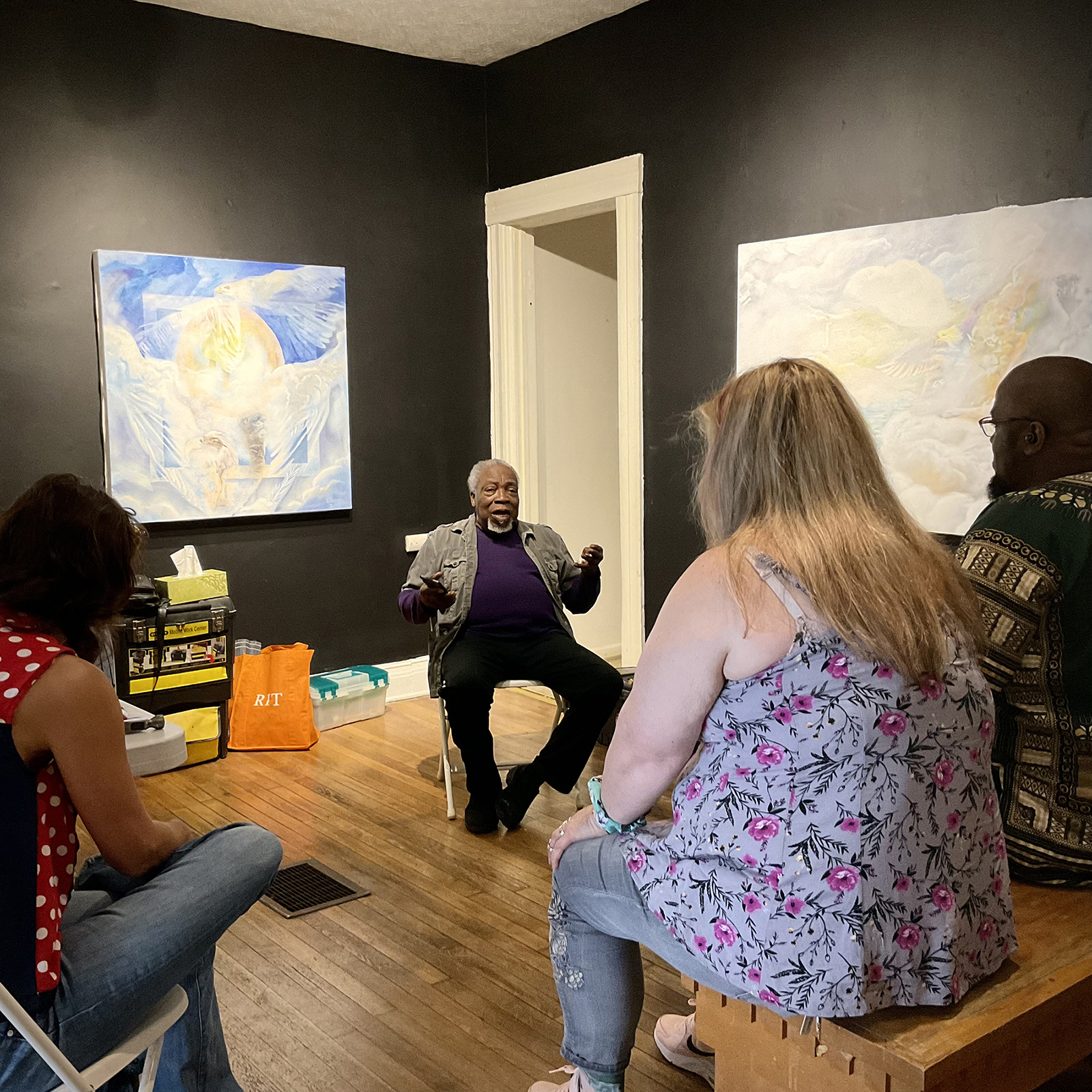 Luvon Sheppard talks with a group of people in his gallery, Joy Gallery.