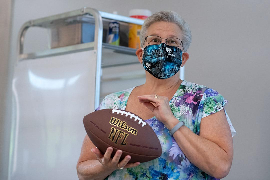 professor holding a football.