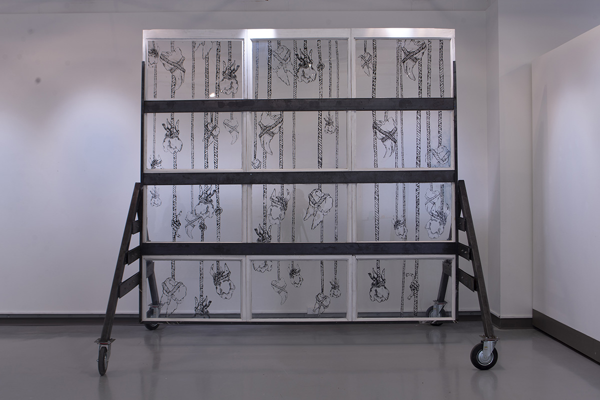 An installation of a structure comprised of screen printing, found objects and fabricated steel.