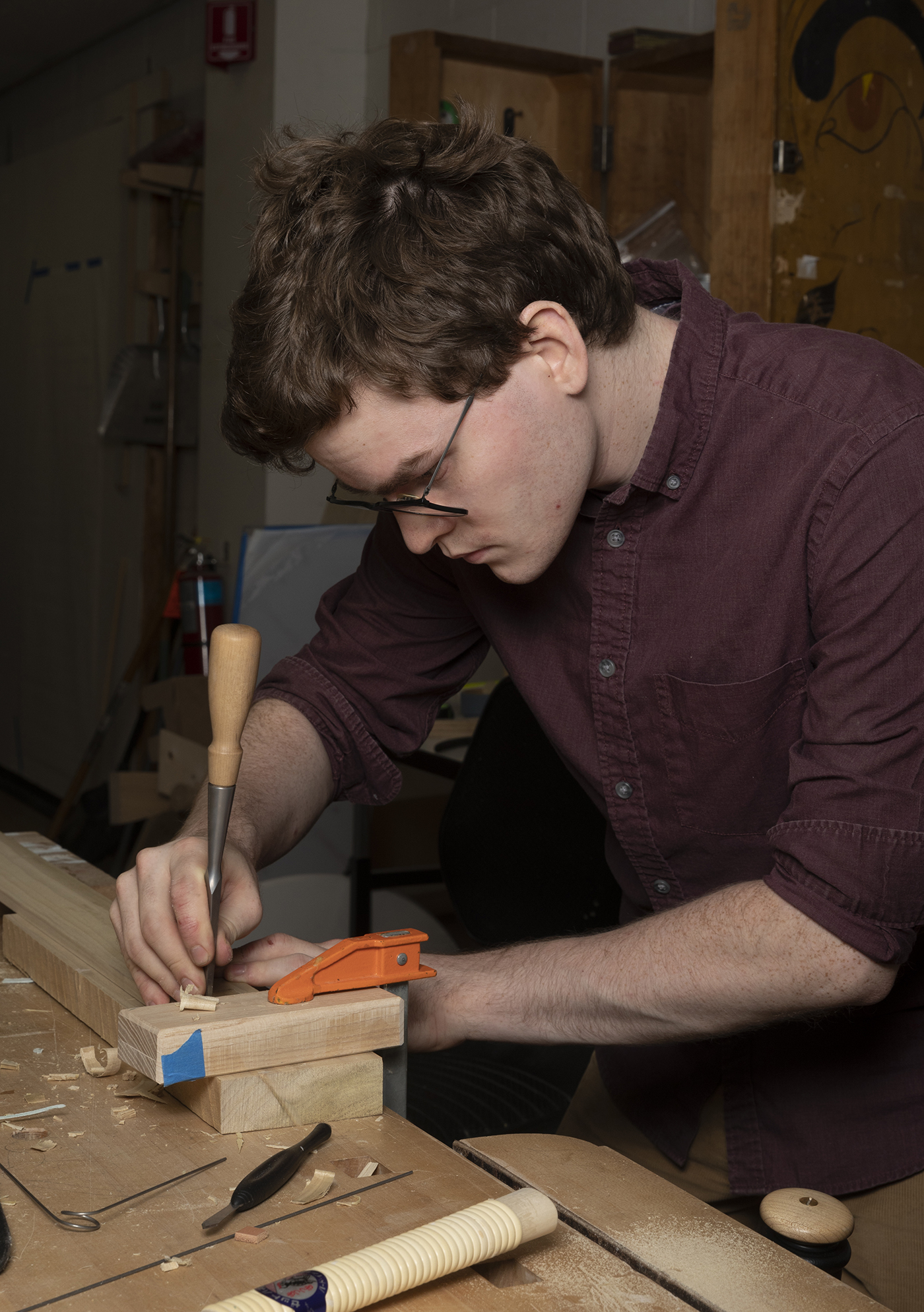 Kelly Cleveland uses a chisel in the furniture design studio.