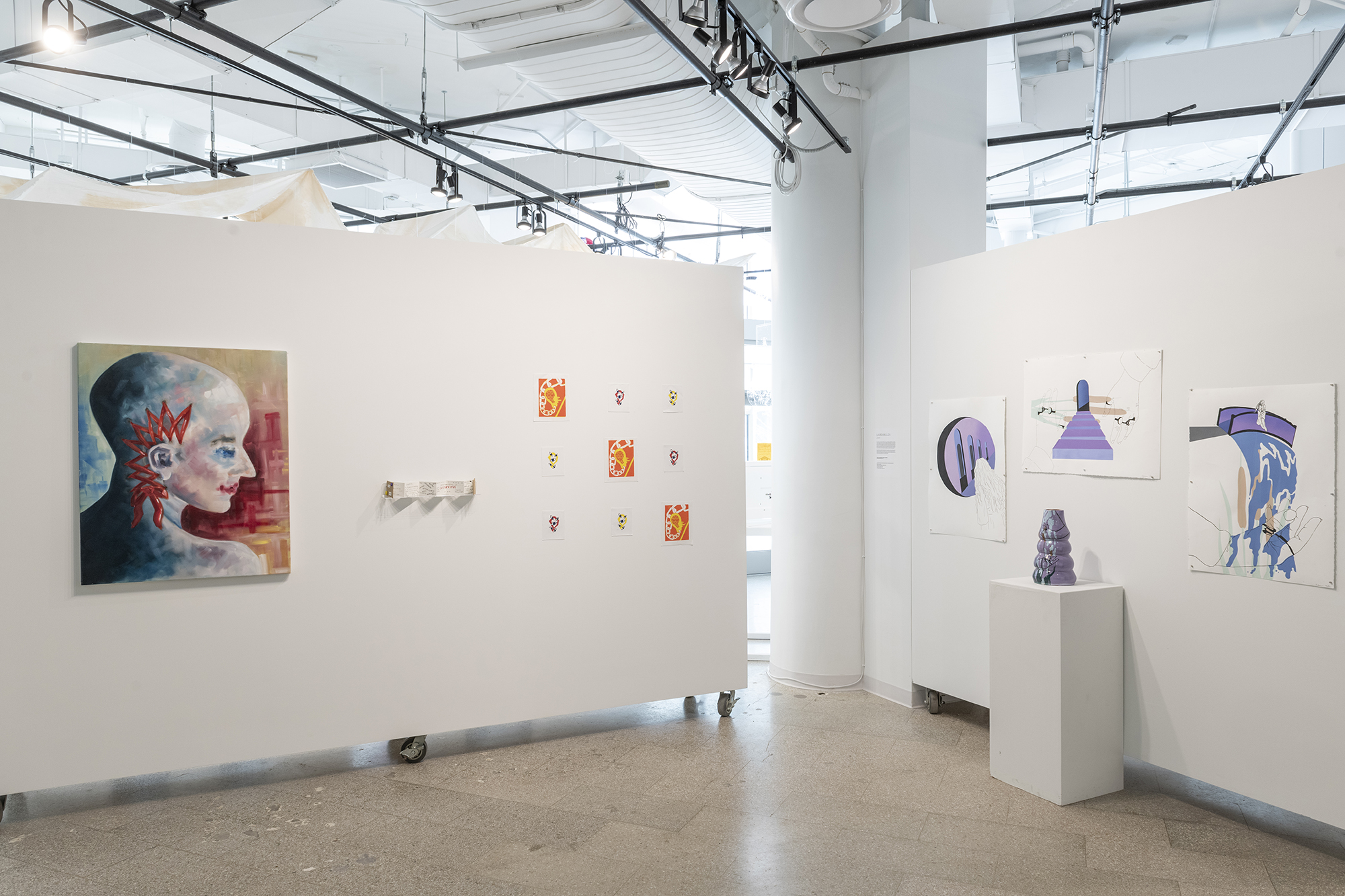 Two gallery walls display colorful paintings.