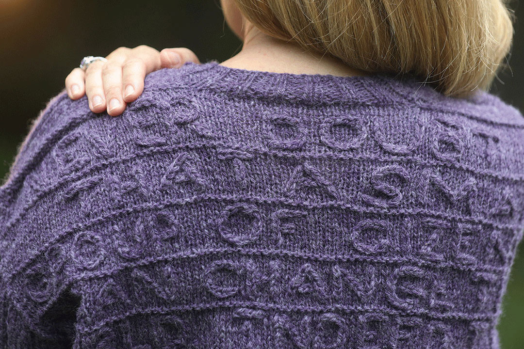 Back of knit purple sweater.