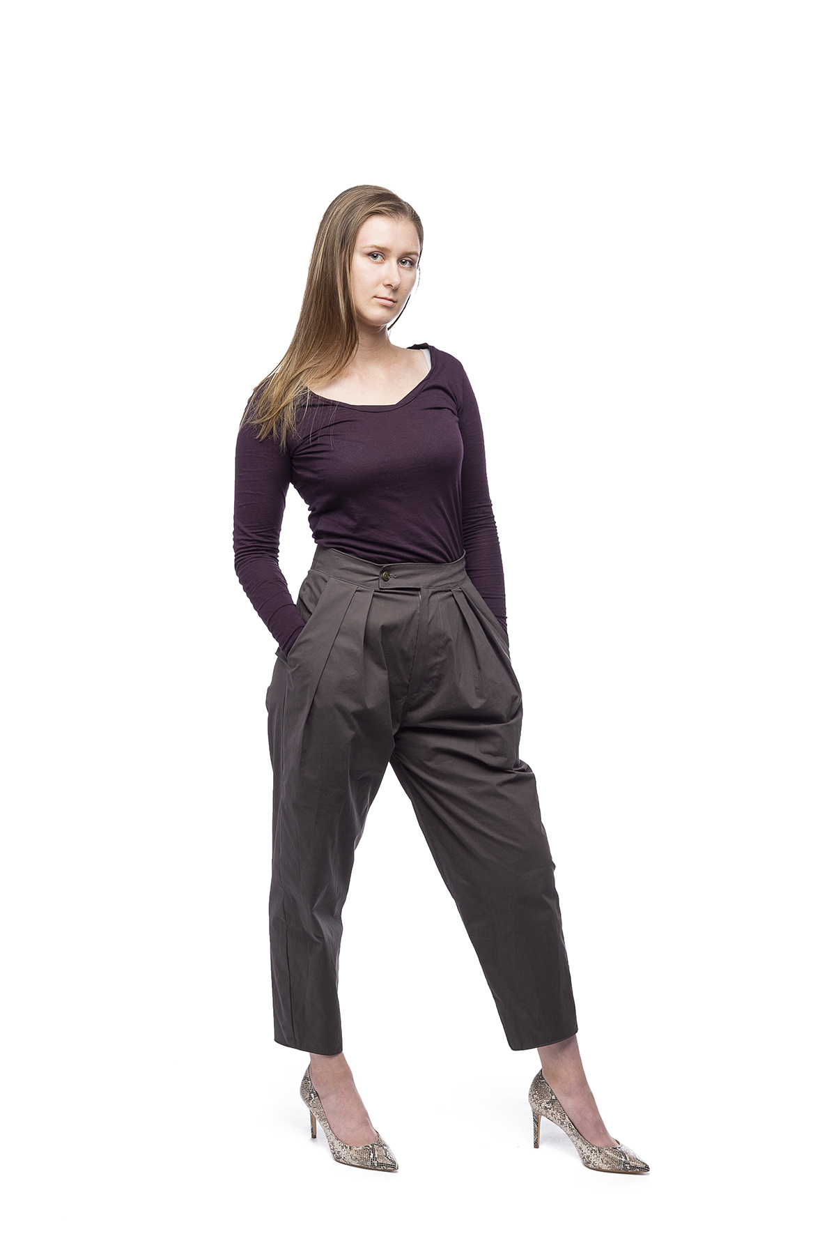 A design of a long-sleeved, dark purple top with high-rise pants and heels.