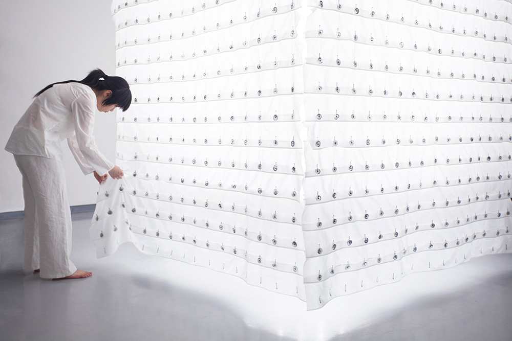 LuLu Meng next to her installation