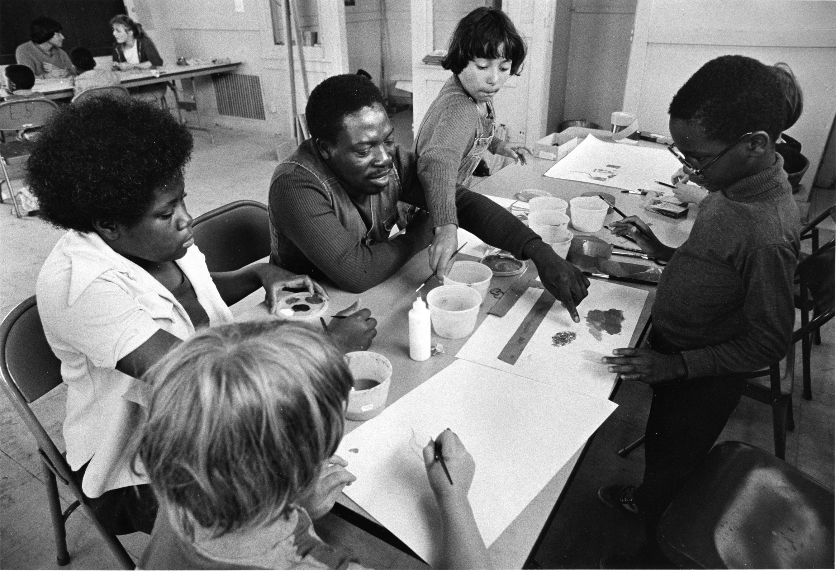 A black-and-white photo of Luvon Sheppard teaching youth in 1981.