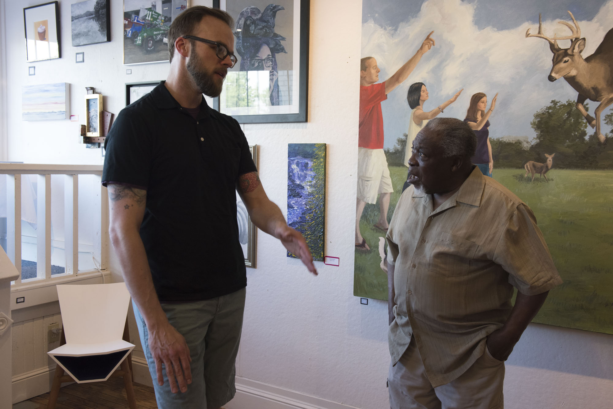 Todd Stahl and Luvon Sheppard chat in Joy Gallery.