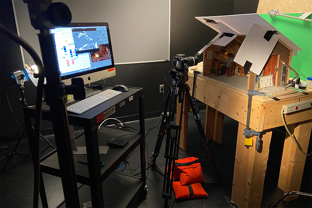 camera and computer recording a stop-motion film scene.
