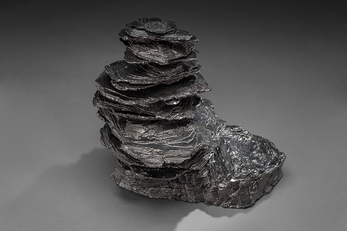 A multi-piece sculpture modeled after rock cairns in the Adirondack Mountains.