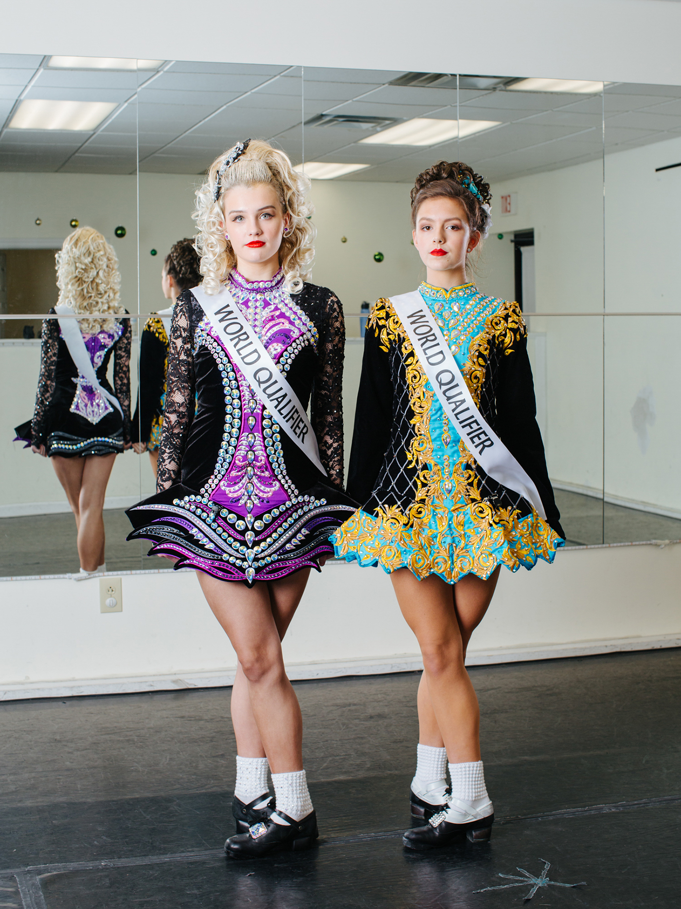 Portrait photography of two dancers standing side-by-side.
