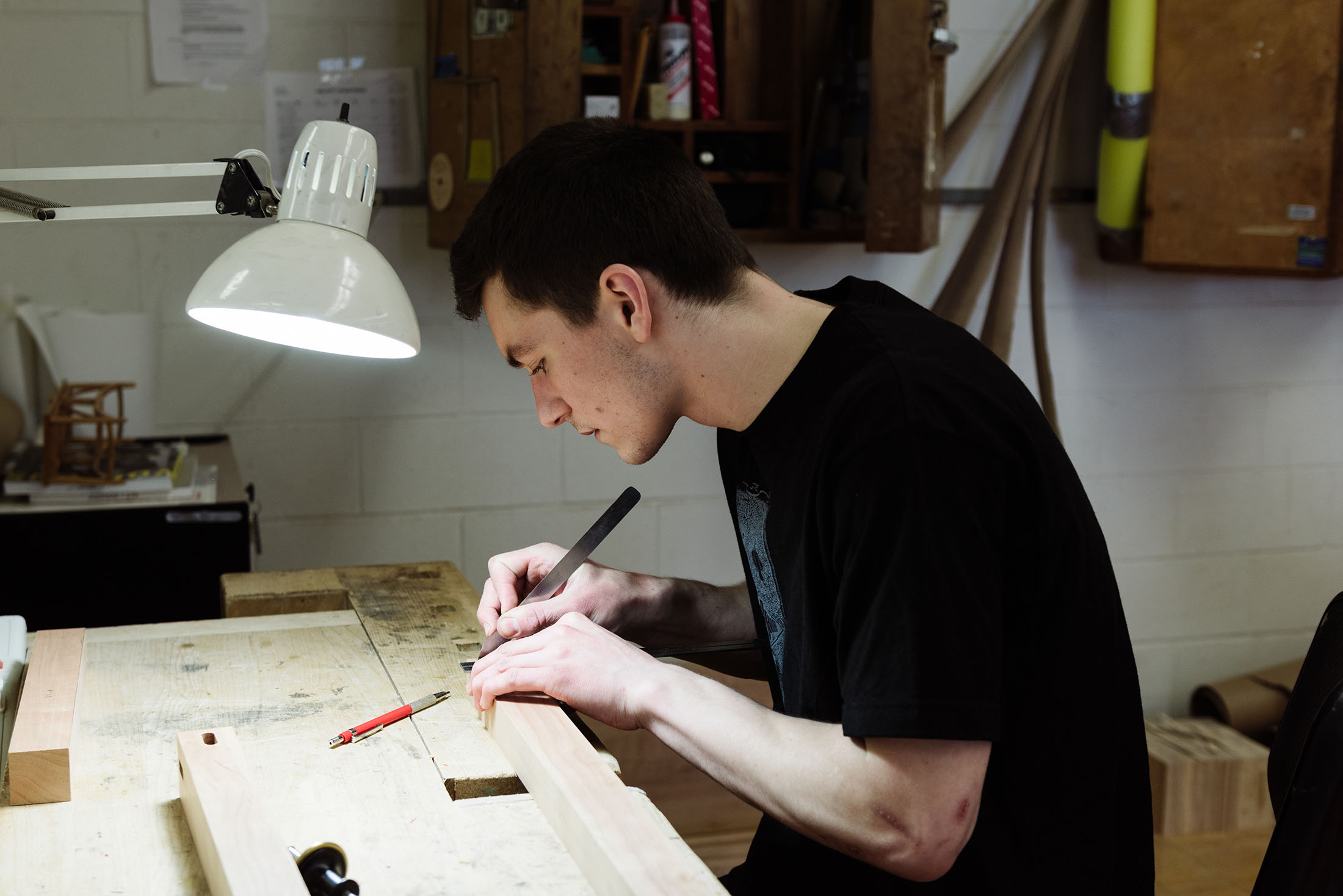 Photo by Monica Gustin: Michael Leach puts in some work in the furniture design studio.