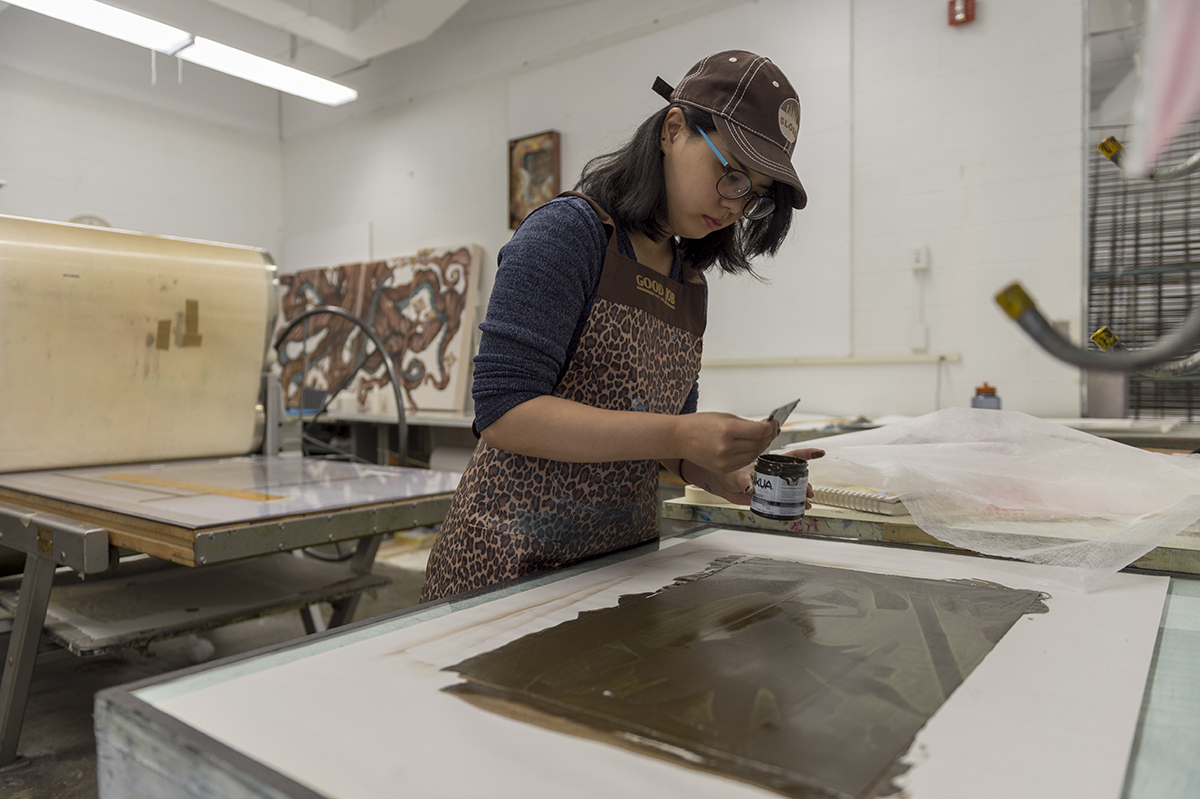 A student works in the printmaking studio