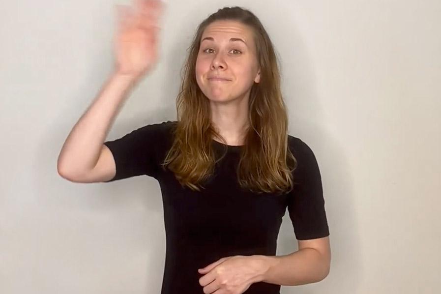 woman using American Sign Language.