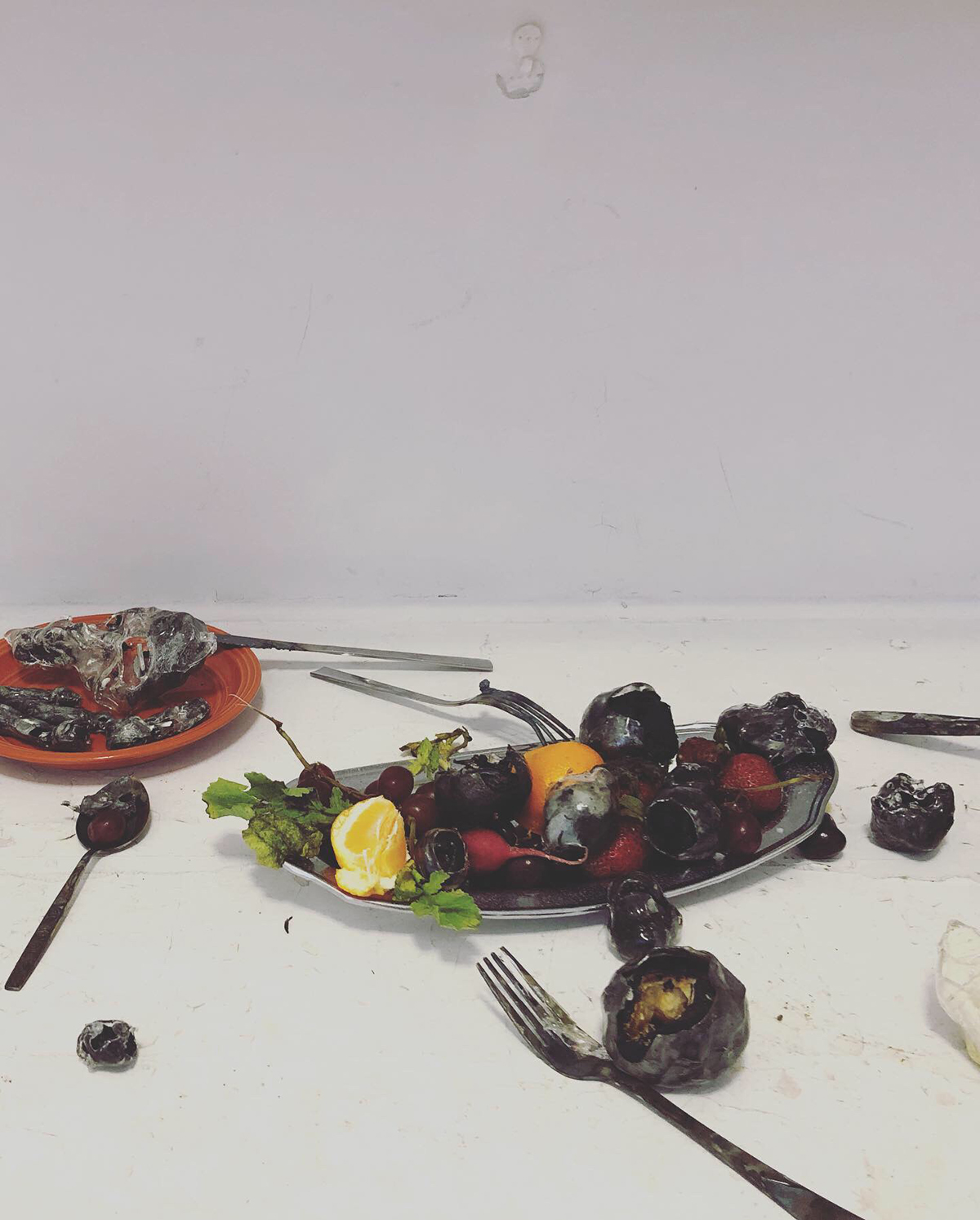 Glass fruit and silverware on a surface. This piece was exhibited at the art festival.