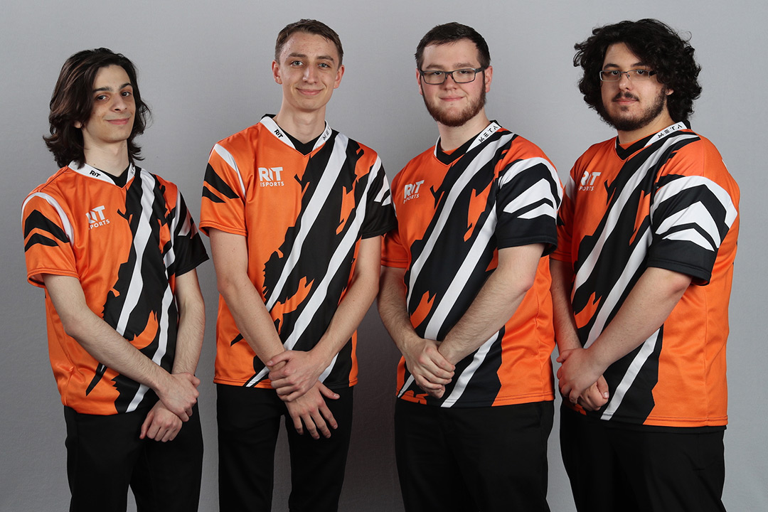 Four esports team members pose.