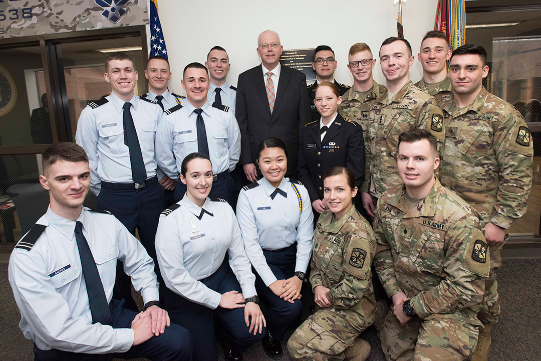 Group of Air Force and Army ROTC cadets pose in uniform