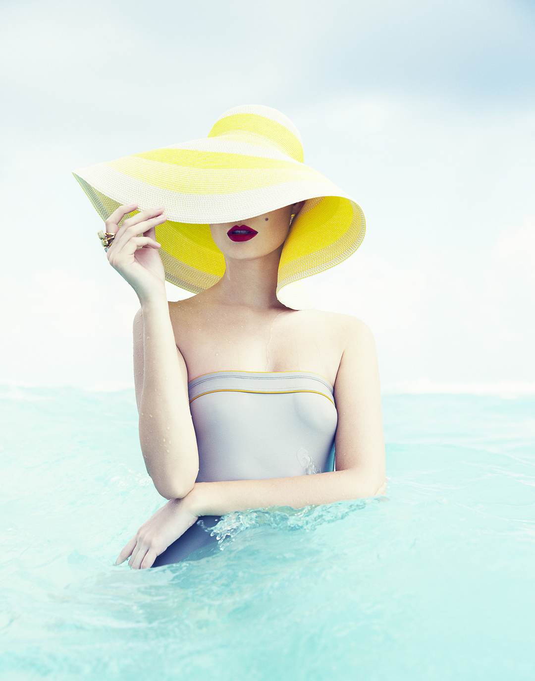 A fashion photo of a woman in water