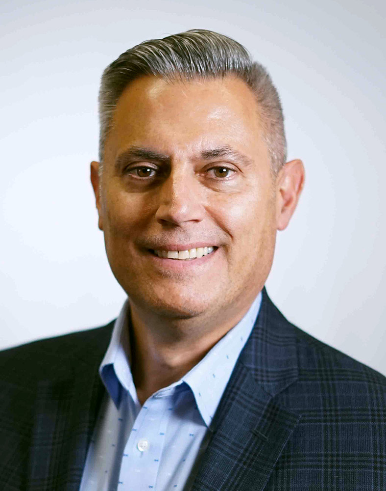 portrait of businessman John Roman.