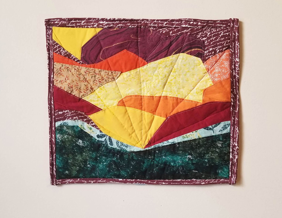 A quilt representing a bright morning glow from the sun.
