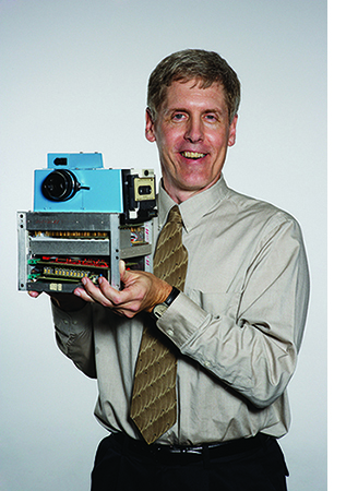 Steve Sasson holds his prototype digital camera.