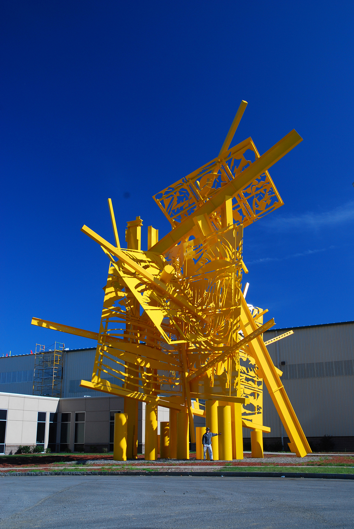 A yellow sculpture by Albert Paley