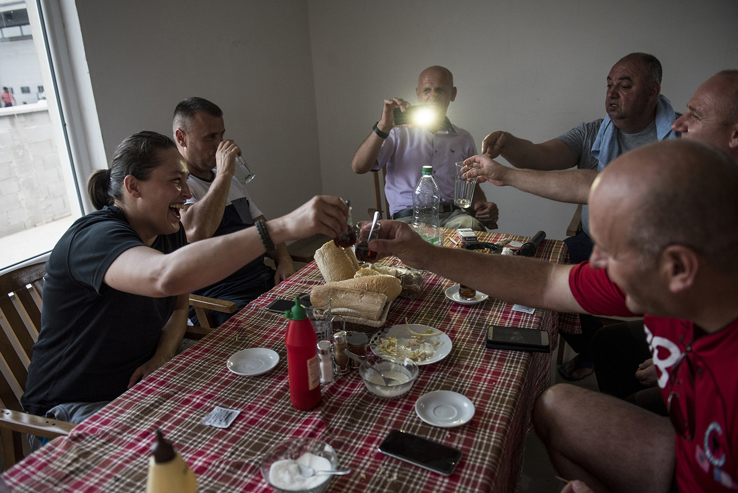 A group of people gathers around the dinner table