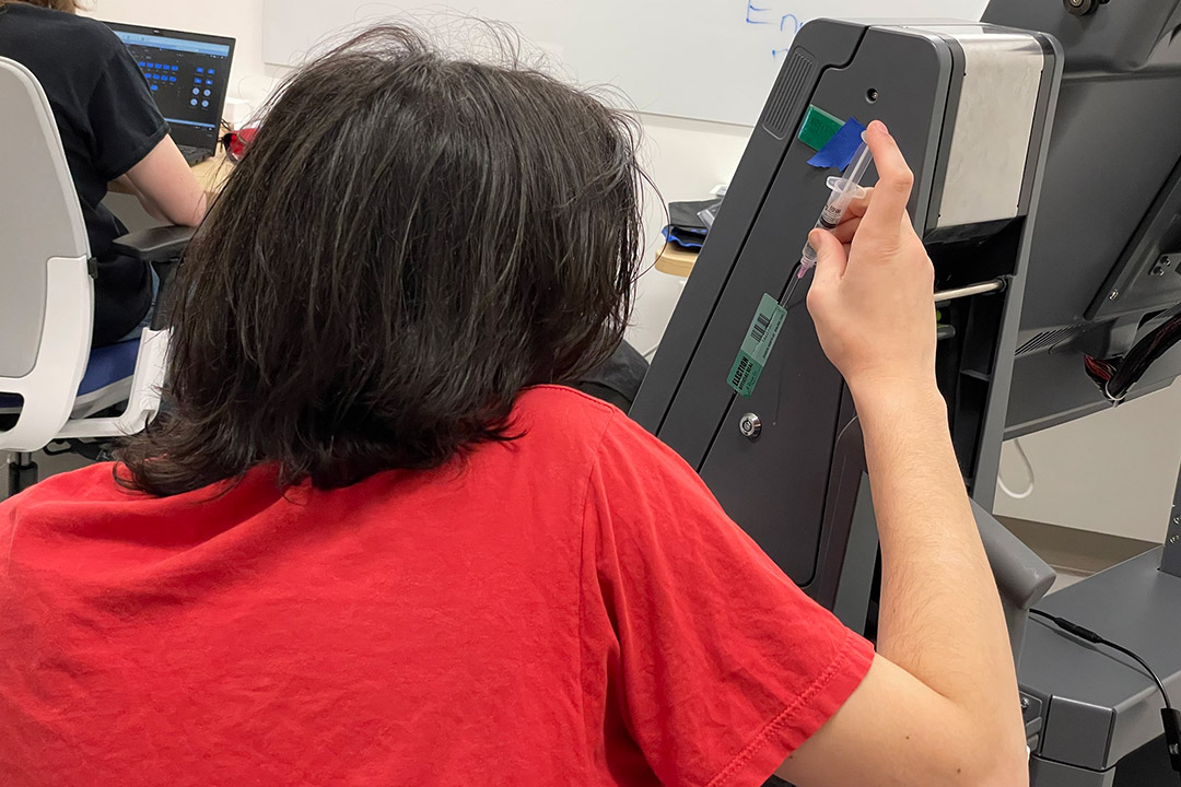students tests tamper seal on a voting machine.